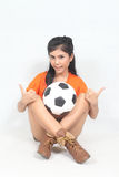 Portrait Beautiful woman hold ball over her head with wearing fo. Image of Portrait Beautiful woman hold ball over her head with wearing football top Royalty Free Stock Image