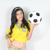 Portrait Beautiful woman hold ball with wearing Brazil football Stock Photo