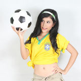Portrait Beautiful woman hold ball with wearing Brazil football Royalty Free Stock Photos