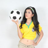 Portrait Beautiful woman hold ball with wearing Brazil football Royalty Free Stock Image