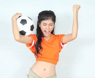 Portrait Beautiful woman hold ball wearing football top,feeling Stock Image