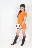 Portrait Beautiful woman hold ball with wearing football top. Image of Portrait Beautiful woman hold ball with wearing football top Royalty Free Stock Photo