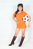 Portrait Beautiful woman hold ball with wearing football top. Image of Portrait Beautiful woman hold ball with wearing football top Royalty Free Stock Images