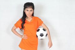 Portrait Beautiful woman hold ball with wearing football top. Image of Portrait Beautiful woman hold ball with wearing football top Royalty Free Stock Photos