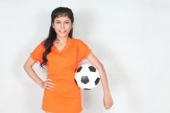 Portrait Beautiful woman hold ball with wearing football top. Image of Portrait Beautiful woman hold ball with wearing football top Royalty Free Stock Image