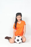 Portrait Beautiful woman hold ball wearing football top Stock Photo