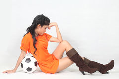 Portrait Beautiful woman hold ball wearing football top Royalty Free Stock Images