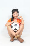 Portrait Beautiful woman hold ball wearing football top Royalty Free Stock Image