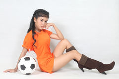 Portrait Beautiful woman hold ball wearing football top Stock Photos