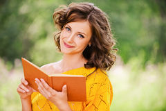 Portrait of beautiful woman holding Stock Photography