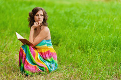 Portrait of beautiful woman holding Stock Images