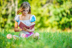Portrait of beautiful woman holding book Royalty Free Stock Photography