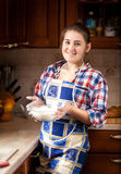 Portrait of beautiful woman holding bowl with flour Stock Photography