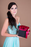 Portrait of beautiful woman holding box with red rose flowers Royalty Free Stock Photo