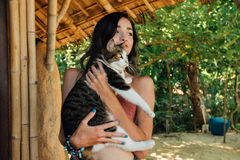 Portrait beautiful woman holding cat in her nands. Attractive brunette with cats. Portrait beautiful woman holding striped cat in her hands and smiling stock images