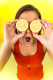 Portrait of beautiful woman holding fresh lemon. Stock Photo