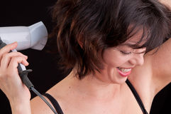 Portrait of beautiful woman, she is holding hair dryer Royalty Free Stock Photos
