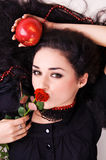 Portrait of a beautiful woman holding a red apple Stock Photo