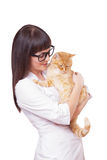 Portrait of a beautiful woman holding red cat Royalty Free Stock Photo