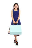 Portrait of beautiful woman holding shopping bags and looking at Royalty Free Stock Photography
