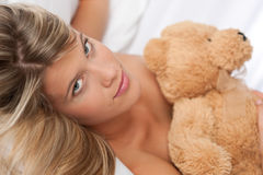 Portrait of beautiful woman holding teddy bear Stock Images