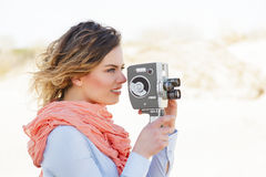 Portrait of beautiful woman holding vintage 8mm camera Stock Photo