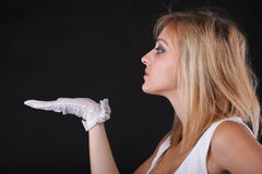 Portrait beautiful woman holding your product on empty hand in white gloves Stock Photography