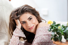 Portrait of beautiful woman at home holding a cup of tea Royalty Free Stock Image