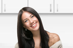Portrait of beautiful woman at home in kitchen Stock Photos