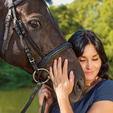 Portrait of a beautiful woman with a horse. Portrait of a beautiful woman with a horse outdoor Royalty Free Stock Image