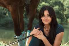 Portrait of a beautiful woman with a horse. Portrait of a beautiful woman with a horse in the summer outdoors Royalty Free Stock Image