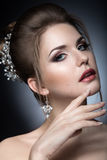Portrait of a beautiful woman in the image of the bride. Beauty face. Stock Photos