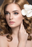 Portrait of a beautiful woman in the image of the bride with flowers in her hair. Beauty face Stock Images