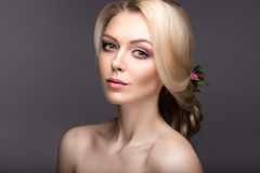 Portrait of a beautiful woman in the image of the bride with flowers in her hair. Beauty face Stock Photos