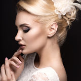 Portrait of a beautiful woman in the image of the bride with flowers in her hair. Royalty Free Stock Photos