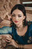 portrait of a beautiful woman in Indian traditional Chinese dres stock photo