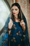 Portrait of a beautiful woman in Indian traditional Chinese dres Royalty Free Stock Photos