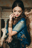 portrait of a beautiful woman in Indian traditional Chinese dres stock image