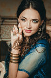 Portrait of a beautiful woman in Indian traditional Chinese dres Royalty Free Stock Photography