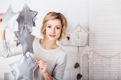 Portrait of a beautiful woman in the interior with Christmas dec Stock Photos