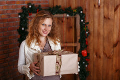 Portrait of a beautiful woman in the interior with Christmas dec Royalty Free Stock Image