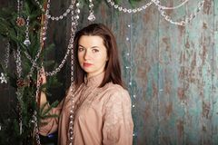 Portrait of a beautiful woman in the interior with Christmas dec Stock Images