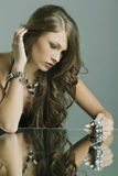 Portrait of a beautiful woman with jewelry Stock Photo