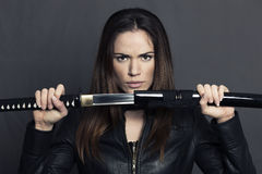 Portrait of beautiful woman with Katana Stock Photography