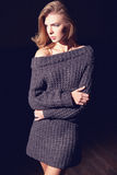 Portrait of beautiful woman in knitted dress. Fashion photo. Blonde girl Royalty Free Stock Photo