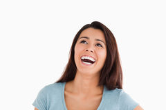Portrait of a beautiful woman laughing. While standing against a white background Stock Photos