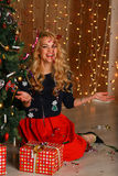 Portrait of beautiful woman laughing and celebrating Christmas. Stock Image