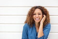 Portrait of a beautiful woman laughing with hand in hair Stock Photography