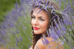 Portrait of beautiful woman in lavender wreath. outdoors