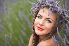 Portrait of beautiful woman in lavender wreath. outdoors Royalty Free Stock Image